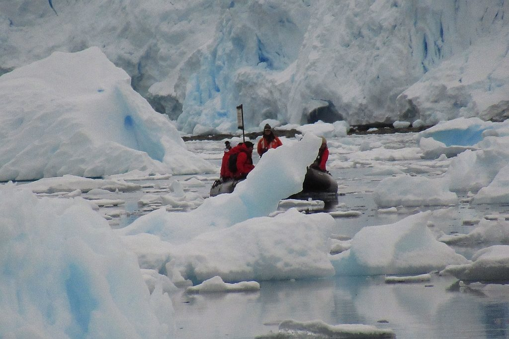 Zodiac navigating glacial ice floes in Paradise Harbour, Antarctica